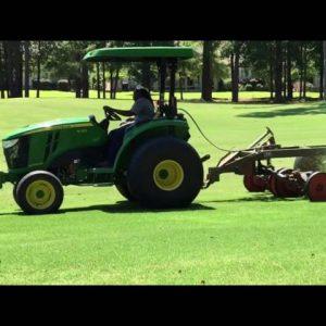 John Deere 4066M Mowing Grass in South Carolina